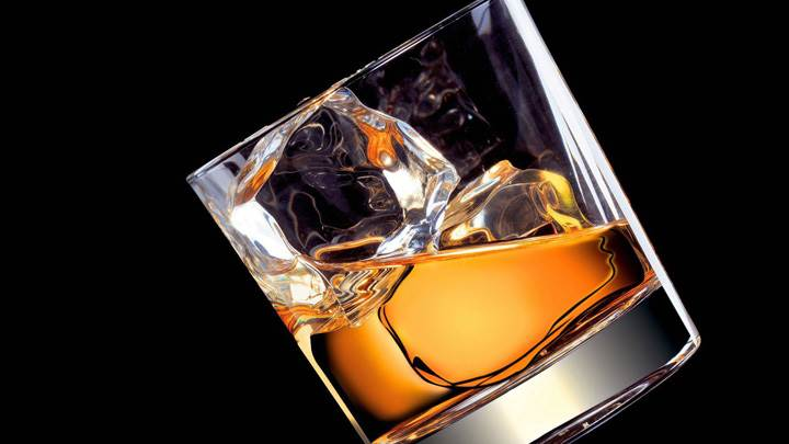 Whiskey In Glass Black Background